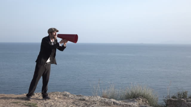 Adult Man Shouting Via Old Fashioned Megaphone In Outdoor