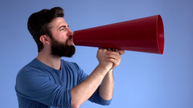 adult man shouting via red old fashioned megaphone - commentator stock videos & royalty-free footage