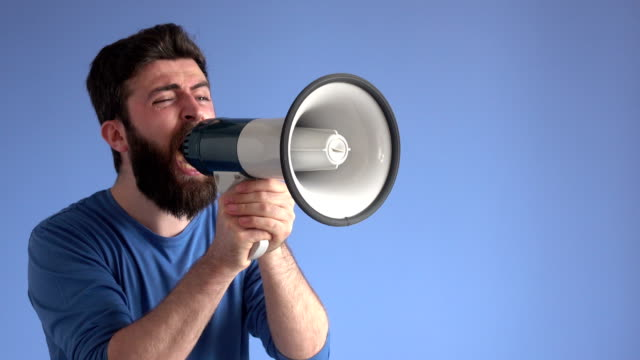 adult man shouting via white modern megaphone - presenter stock videos & royalty-free footage