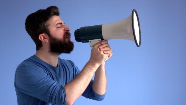 adult man shouting via white modern megaphone - megaphone stock videos & royalty-free footage