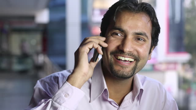 adult man talking on a mobile phone - goatee stock videos & royalty-free footage