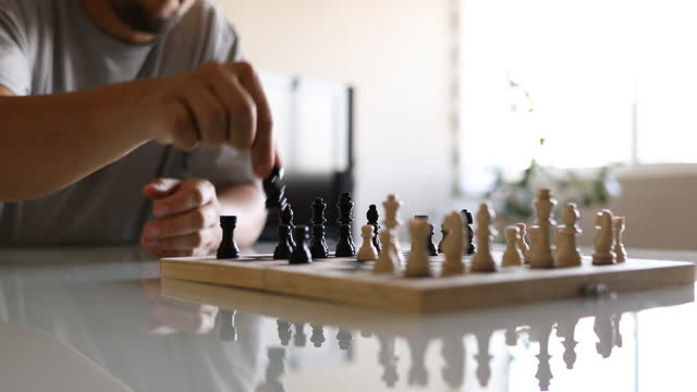 adult man thinking and making a move in chess game - dia stock videos & royalty-free footage