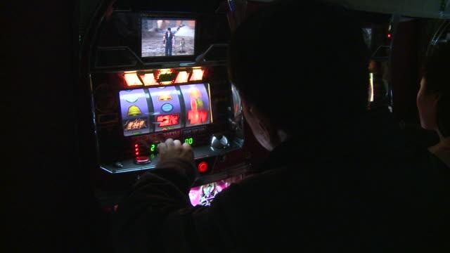 adult man using gambling machine in north korea - fruit machine stock videos & royalty-free footage