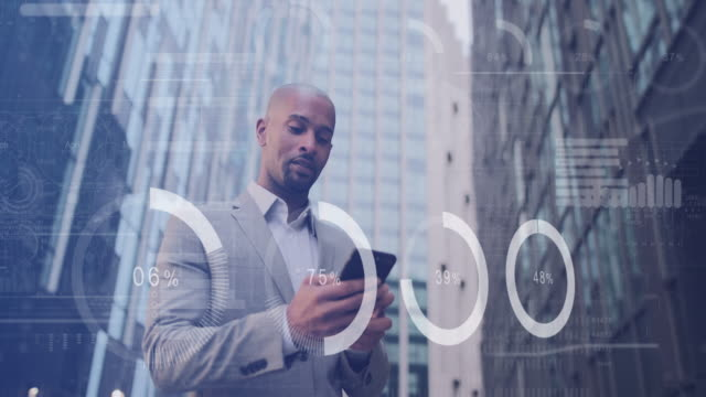 adult man using smart phone outside office with animation digital business graphs - data stock videos & royalty-free footage