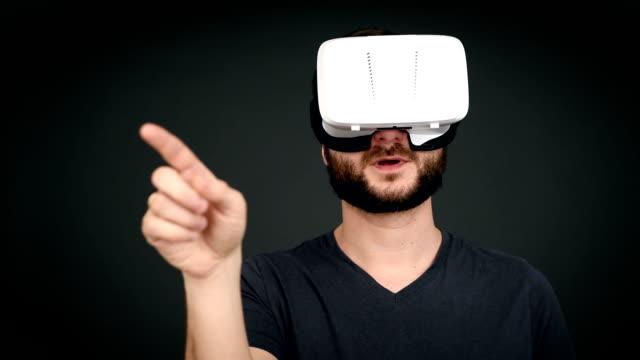 adult man using virtual reality glasses