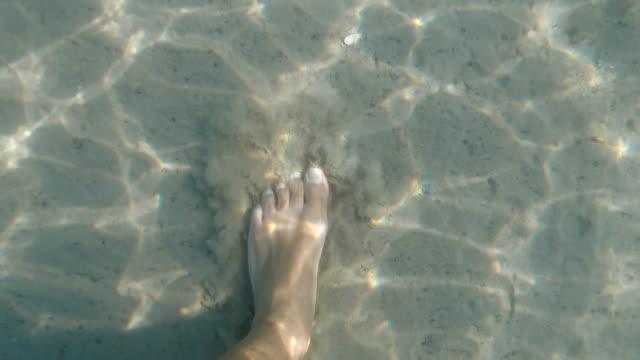 adult man walking barefoot on sandy sea floor - footprint stock videos & royalty-free footage