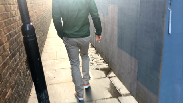 adult man walking down an alley - one man only stock videos & royalty-free footage