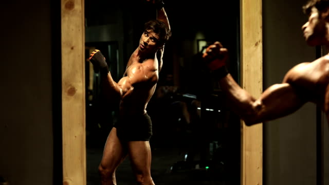 adult man watching his body in mirror, delhi, india - mirror stock videos and b-roll footage
