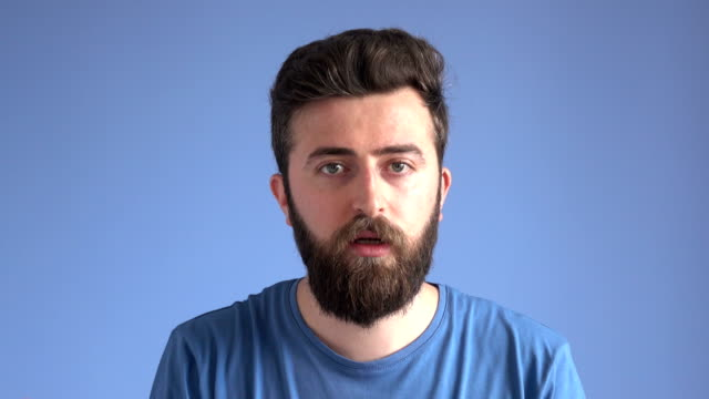 Adult Man With Facial Hair Talking
