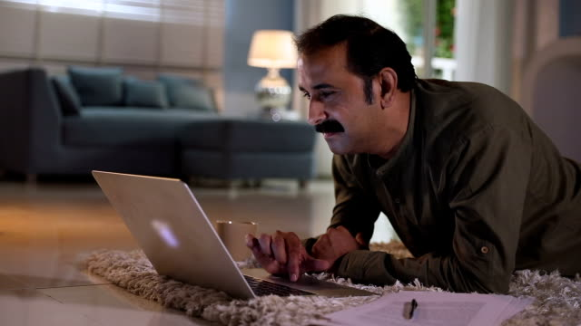 adult man working on laptop at home, delhi, india - moustache stock videos and b-roll footage