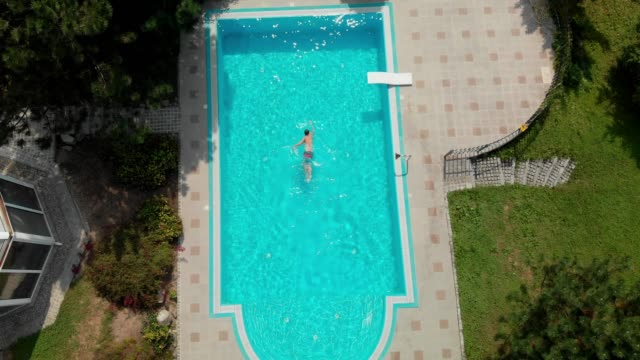 adult men swimming crawl in the pool - lido stock videos & royalty-free footage