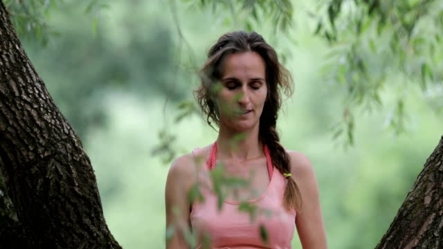 adult pregnant woman sitting on a tree and relaxing - three quarter length stock videos & royalty-free footage
