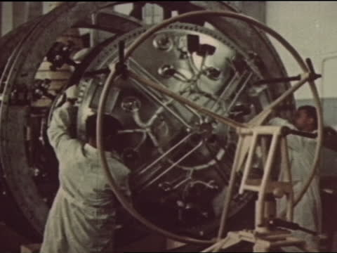 adult russian male specialist moving the cone of sputnik 3 on a wheeled platform. two adult russian men pulling off circular hatch at the base of the... - space exploration stock videos & royalty-free footage