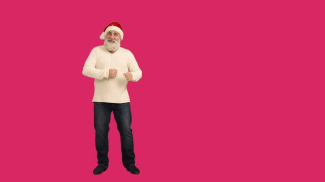 adult senior beard man dancing and invites to join him on a crimson background - santa hat stock videos & royalty-free footage