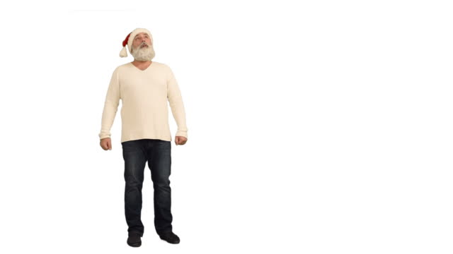 adult senior beard man  it looks and wrapped around himself in a hat santa claus  on a white background - santa hat stock videos & royalty-free footage