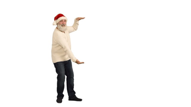 adult senior beard man showing an copy space and  crosses his arms in a hat santa claus  on a white background - santa hat stock videos & royalty-free footage