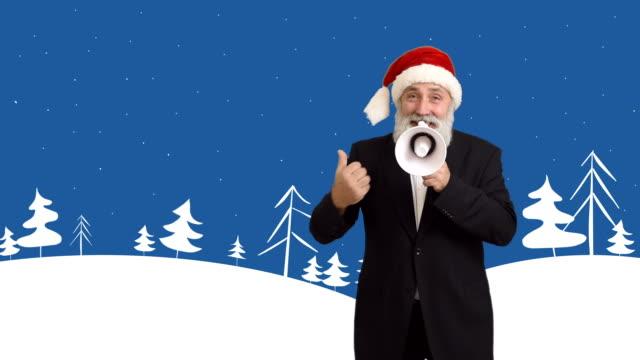 大人男性ひげの老人コピースペースのサンタクロースの帽子、イラストメガホンを背景にした冬のテーマ - winter点の映像素材/bロール