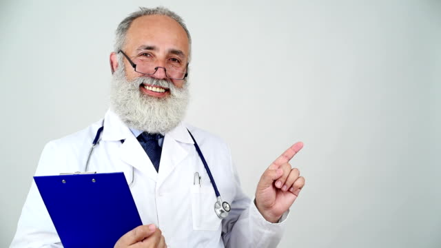 adult senior doctor showing copy space and shows thumb up on a grey background - shirt and tie stock videos & royalty-free footage