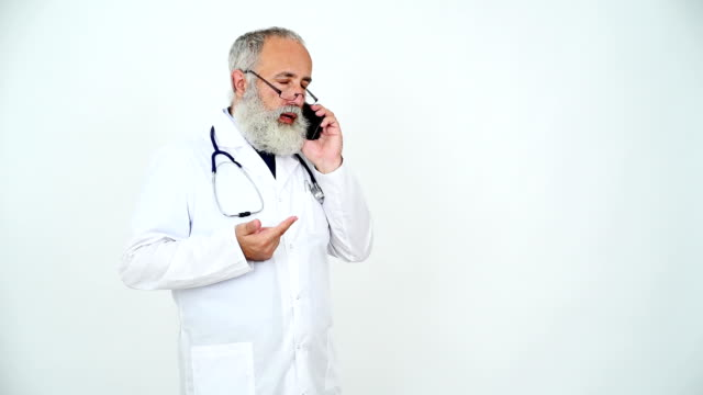 Adult senior doctor talking with the patient on the smartphone