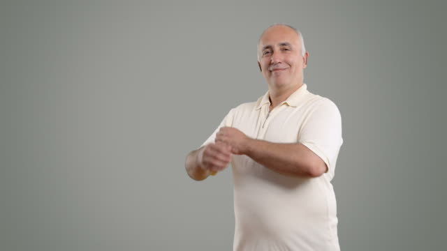 adult senior man crosses his arms and looks smiling - white shirt stock videos & royalty-free footage