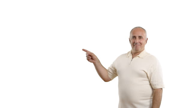 adult senior man showing copy space and showing thumb - white shirt stock videos & royalty-free footage