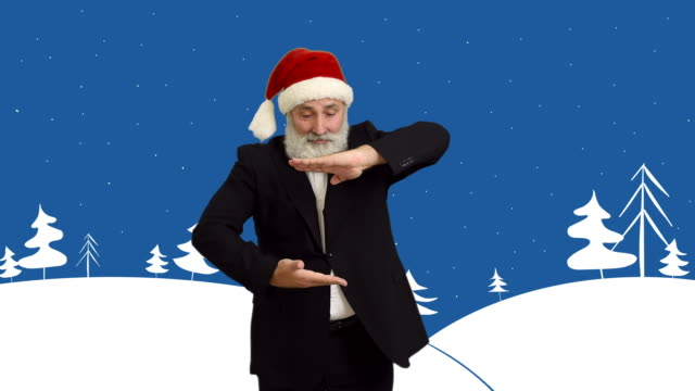 adult senior man shows copy space  in a hat santa claus  on a cartoon background on the theme of winter