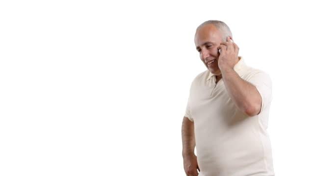 adult senior man talking on the phone on white background - white shirt stock videos & royalty-free footage