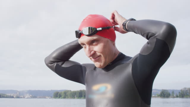 adult senior triathlete preparing for a swim - 50 59 years stock videos & royalty-free footage