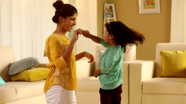 adult woman dancing with her daughter at home, delhi, india - halbnahe einstellung stock-videos und b-roll-filmmaterial