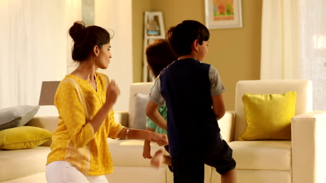 adult woman dancing with her kids at home, delhi, india - daughter stock videos & royalty-free footage