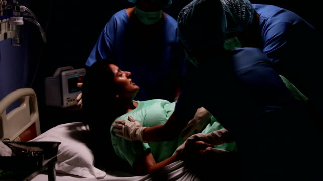 adult woman delivering a baby in a hospital, delhi, india - childbirth stock videos and b-roll footage