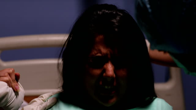 adult woman delivering a baby in a hospital, delhi, india - geburt stock-videos und b-roll-filmmaterial