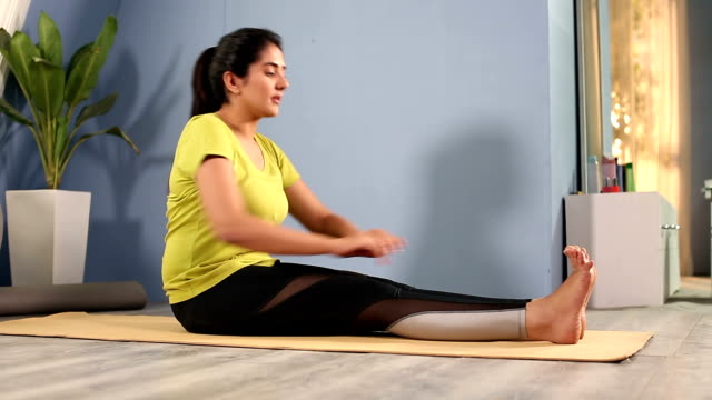 Adult woman doing exercise at home, Delhi, India