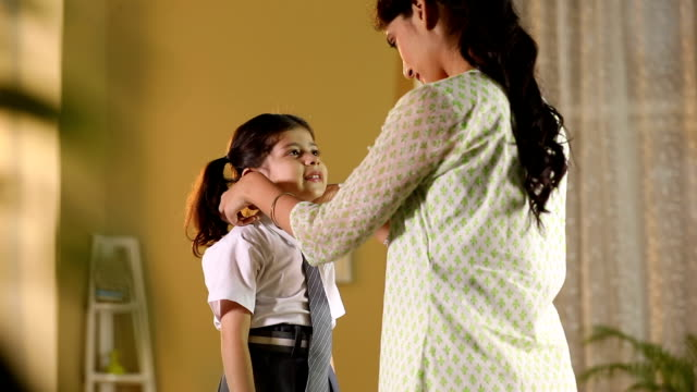 adult woman getting dressed her daughter for school, delhi, india - krawatte stock-videos und b-roll-filmmaterial