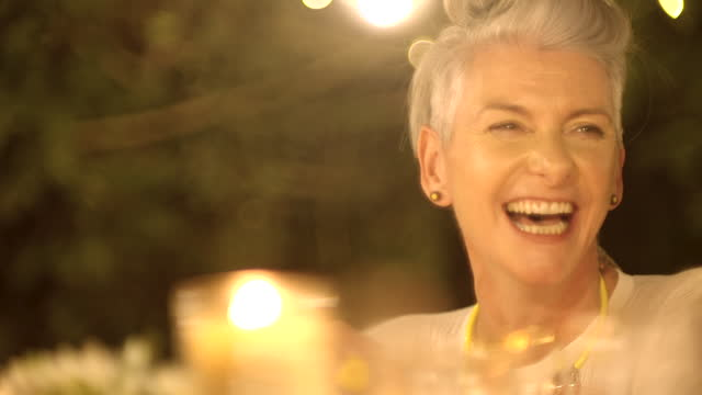 adult woman laughing close up profile - grey hair stock videos & royalty-free footage