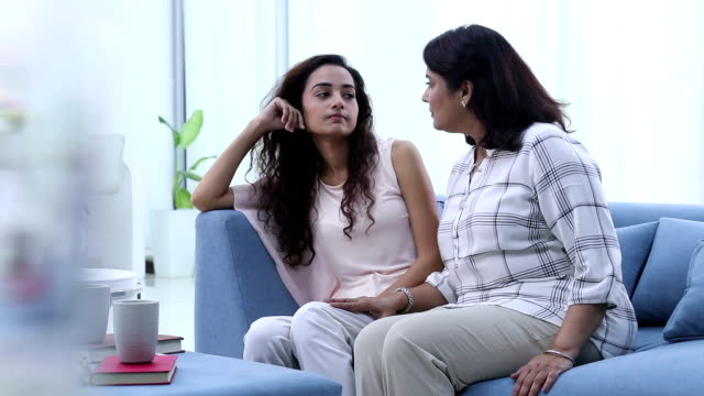 adult woman loving her sad daughter, delhi, india - adult offspring stock videos and b-roll footage