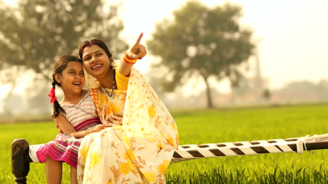 adult woman playing with her daughter in the farm, haryana, india - haryana stock-videos und b-roll-filmmaterial