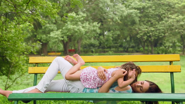 adult woman playing with her daughter in the park, delhi, india - 2013 stock videos and b-roll footage