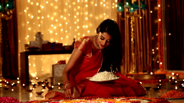 Adult woman preparing rangoli in diwali festival, Delhi, India