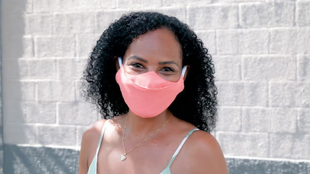 adult woman putting on protective mask. - quarantine stock videos & royalty-free footage