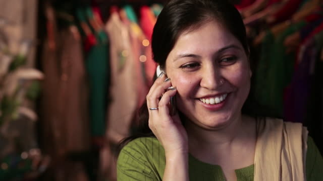 adult woman talking on a mobile phone - only mid adult women stock videos & royalty-free footage