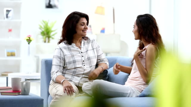 adult woman talking with her daughter, delhi, india - adult offspring stock videos & royalty-free footage