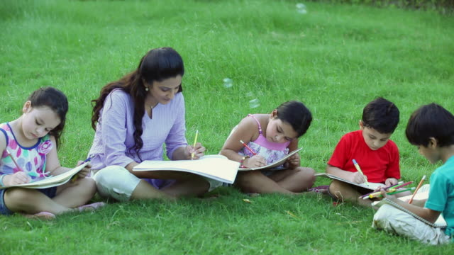 Adult Woman Teaching To Kids In The Park Delhi India Stock