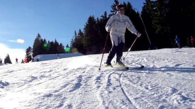 HD: Adult women skiing slalom