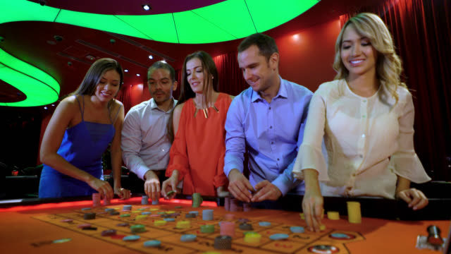 adults at the casino gambling on the roulette - roulette stock videos and b-roll footage