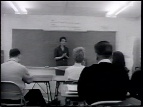 adults male female sitting in classroom w/ woman standing in front of class lecturing dolly up row ms teacher possibly pilot pan classroom of seated... - captain stock videos and b-roll footage