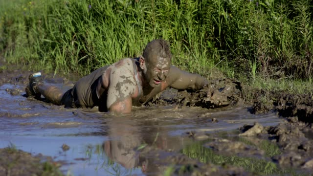 adults participating in a mud run - obstacle course stock videos & royalty-free footage
