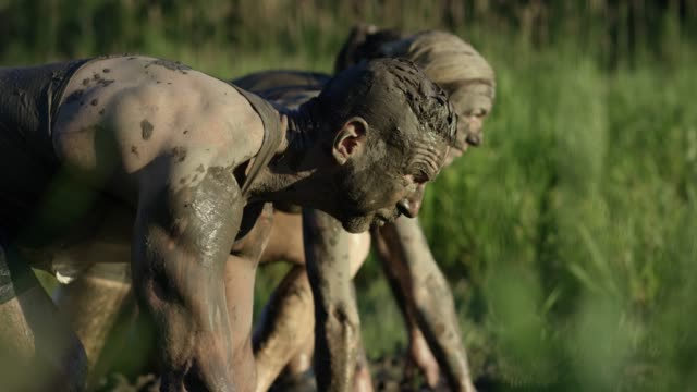 adults participating in a mud run - conquering adversity stock videos & royalty-free footage