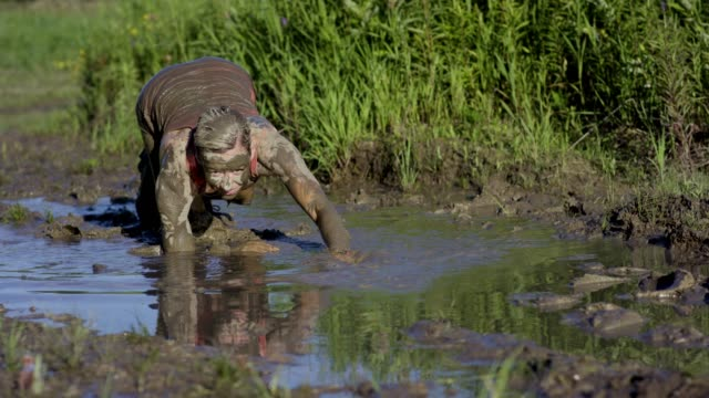 adults participating in a mud run - superwoman stock videos and b-roll footage