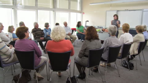 hd dolly: adults participating the group discussion - person in further education stock videos & royalty-free footage